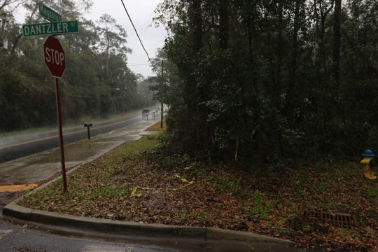 Crime scene tape remains at the corner of Dantzler and Magnolia drives where Shawnez Williams' body was found on Saturday morning. She is believed to be the second victim of Philip Ford, who was arrested on two counts of first-degree murder Monday.
