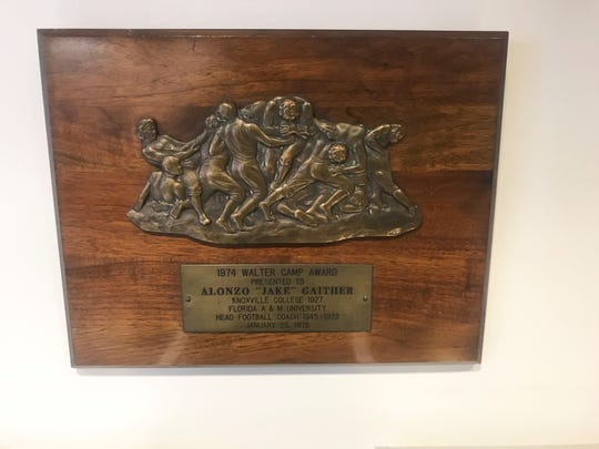 The 1974 Walter Camp Award was presented to Jake Gaither. This plaque is kept at the Meek-Eaton Black Archives.