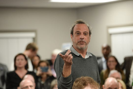 Don Quarello, owner of Waterworks, speaks to the need for parking to support his business in Midtown during a meeting at the Tallahassee Board of Realtors office to discuss the building of a parking structure in Midtown Monday, Jan. 28, 2019.