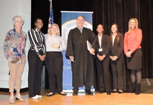 Jensen Beach High School: Kate Boland, president of Center for Constitutional Values; contestants Chandler Scott and Tabitha Bean; Judge William Roby; contestants Emily Sarkar and Shea Powers; and School District representative Dr. Tracy Miller.