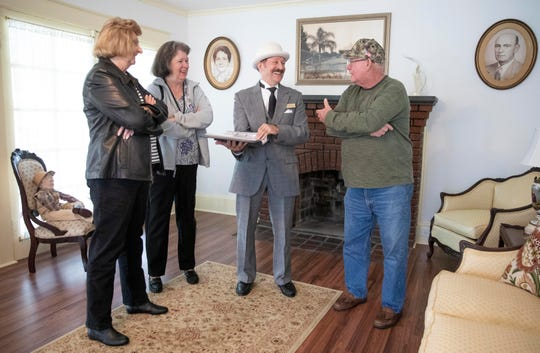 """""""It was in an extremely deteriorated condition. Most of the contractors said to tear it down. It's fantastic that Pat and Cornelius bought it and were able to put the money into it and save it,"""" said Rich Votapka (center), the Fellsmere historian, who talks with members of the Sebastian Historical Society, Ann Gearhart (from left), Kathy McDonald, and Patrick Morgan (right) about the renovation of the Frank and Stella Heiser House during an open house on Saturday, Jan. 26, 2019, in Fellsmere. The home was built in 1915 and is on the National Register of Historic Places and is listed as a Florida Heritage Site. Frank Heiser was responsible for constructing  the Fellsmere fertilizer plant, sugar mill and refinery. Cornelius and Patricia du Plessis bought the home at auction and restored it."""