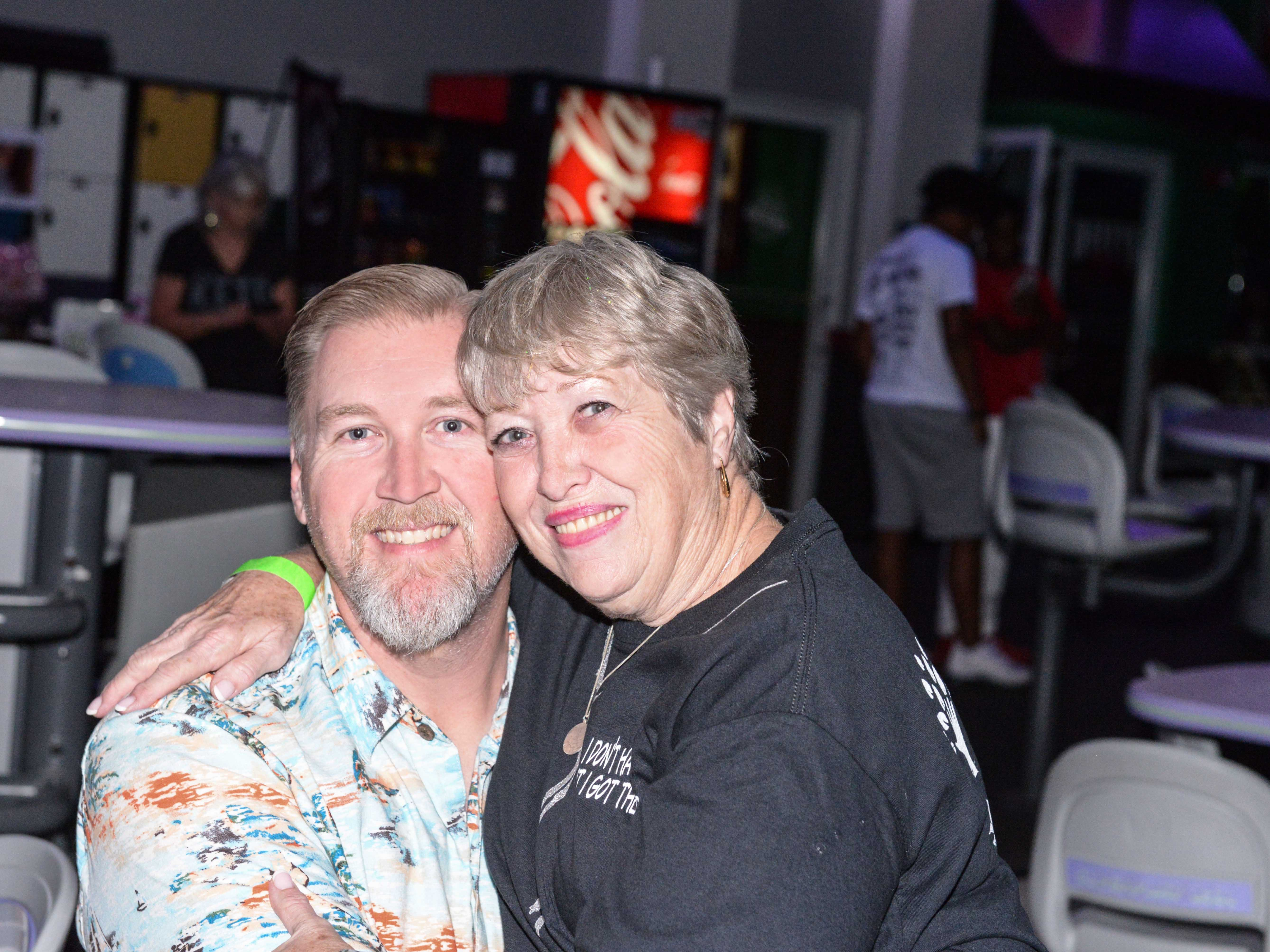 Marc and Tena Sigmon at the Cosmic Family Fun event  to support HANDSof St. Lucie County.