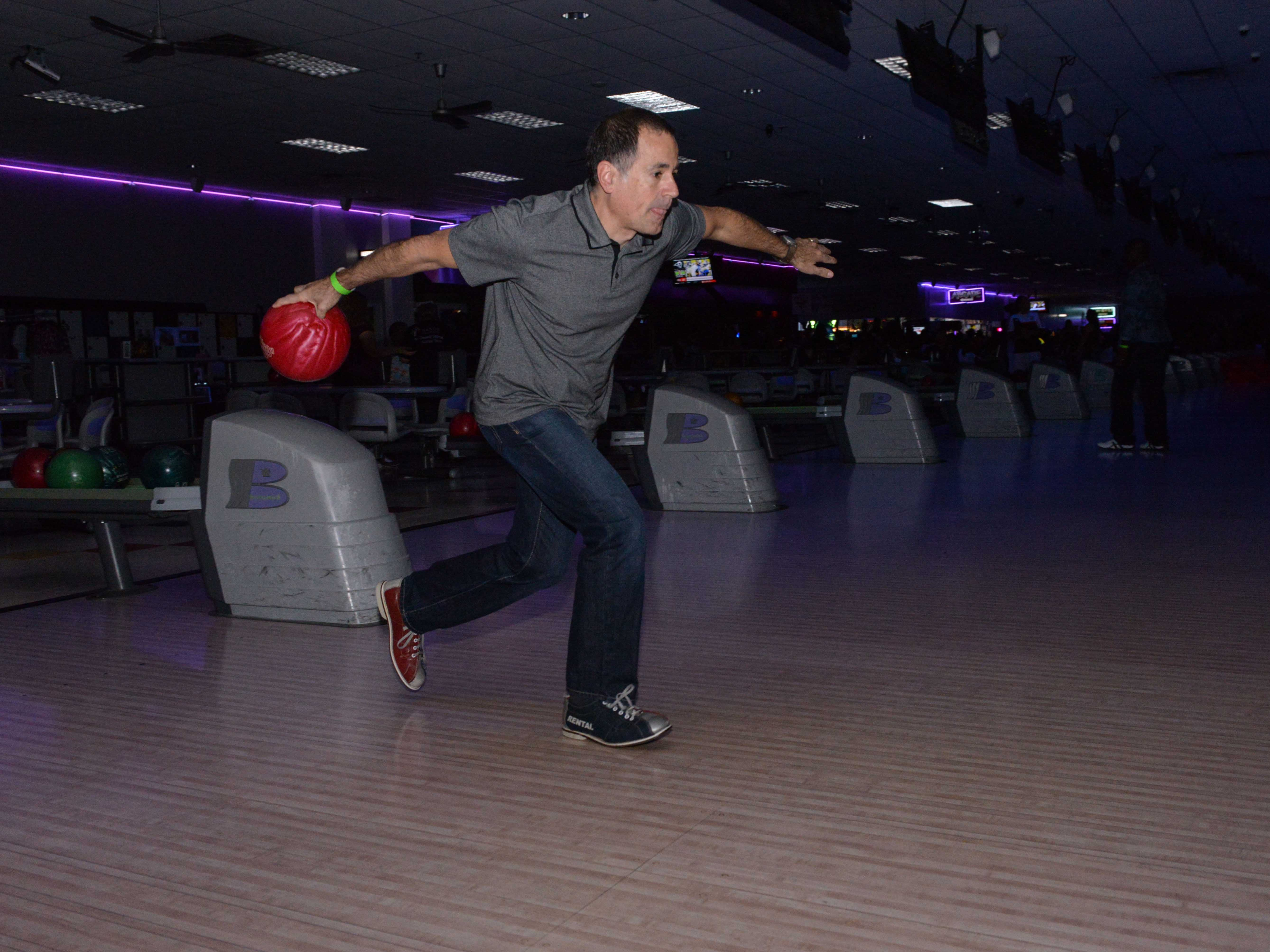 Barry Abraham goes for a strike at the Cosmic Family Fun event  to support HANDSof St. Lucie County.