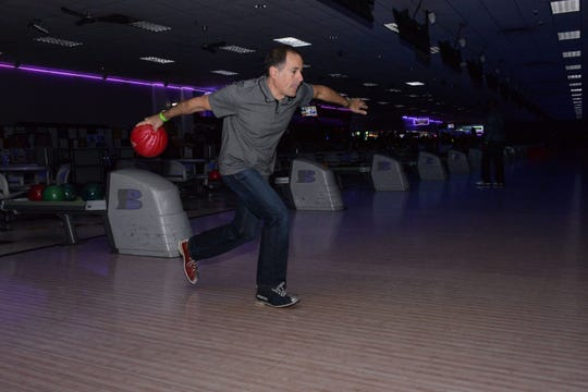 Barry Abraham goes for a strike at the Cosmic Family Fun event  to support HANDS of St. Lucie County.