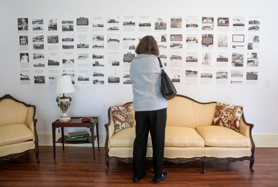 """""""It's a wonderful testament to the endurance and strength of the early settlers of Fellsmere,"""" said Kathy McDonald, center, the president of the Sebastian Historical Society, who reads about the history of Fellsmere during an open house and tour of the Frank and Stella Heiser House on Saturday, Jan. 26, 2019, in Fellsmere."""