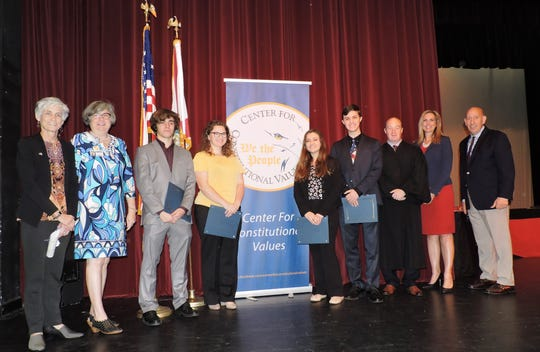 South Fork High School: Kate Boland, left, president of Center for Constitutional Values; Christa Li of Martin County School Board; contestants Dylan Dalal, Abby Gordon, Nicole Daly and Jeremy Ortmann; Judge Darren Steele, and Dr. Tracy Miller and Mark Malham of the School District.