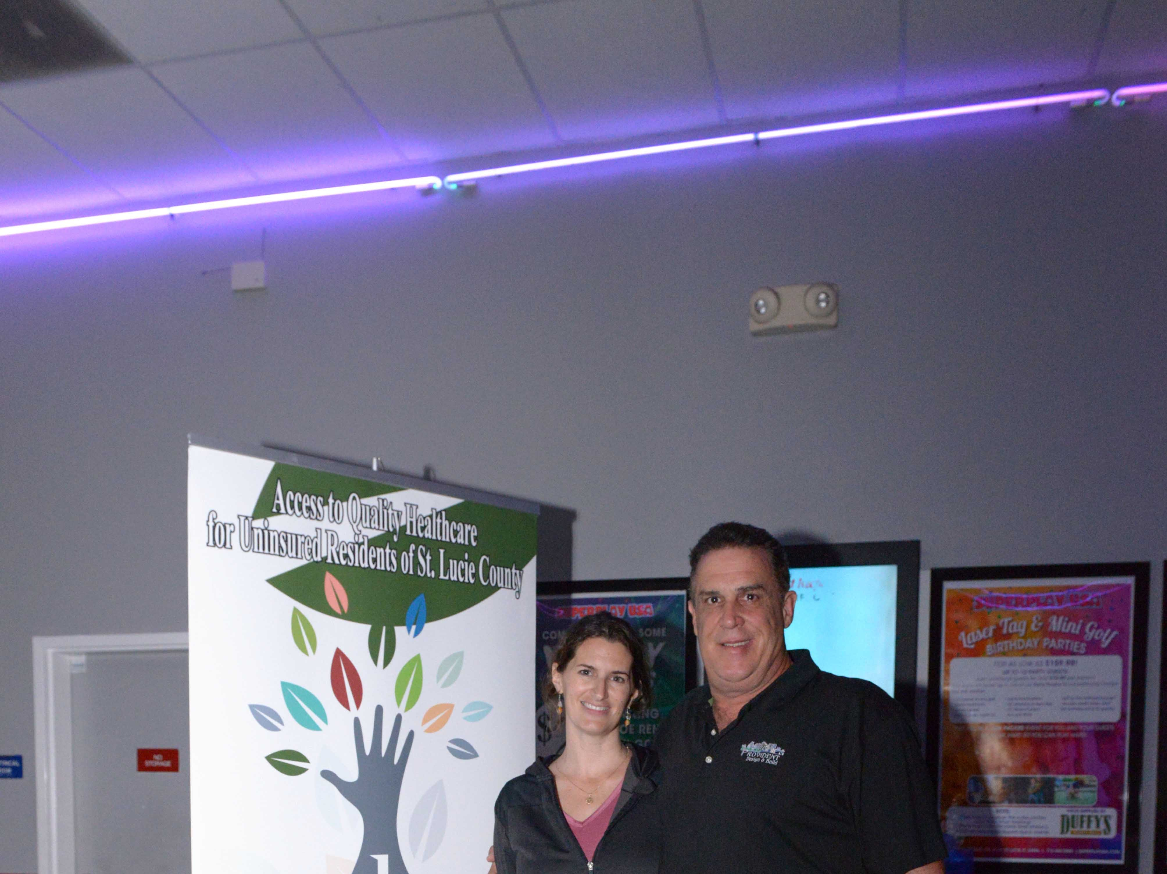 Jessica and John Gaffney attend the Cosmic Family Fun event  to support HANDSof St. Lucie County.