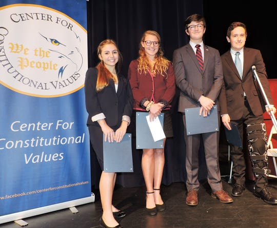 Martin County High School: Team members Jordan Losardo, left, and Jillian Plymale with team members Sam Cromie and Nick Ciampi.