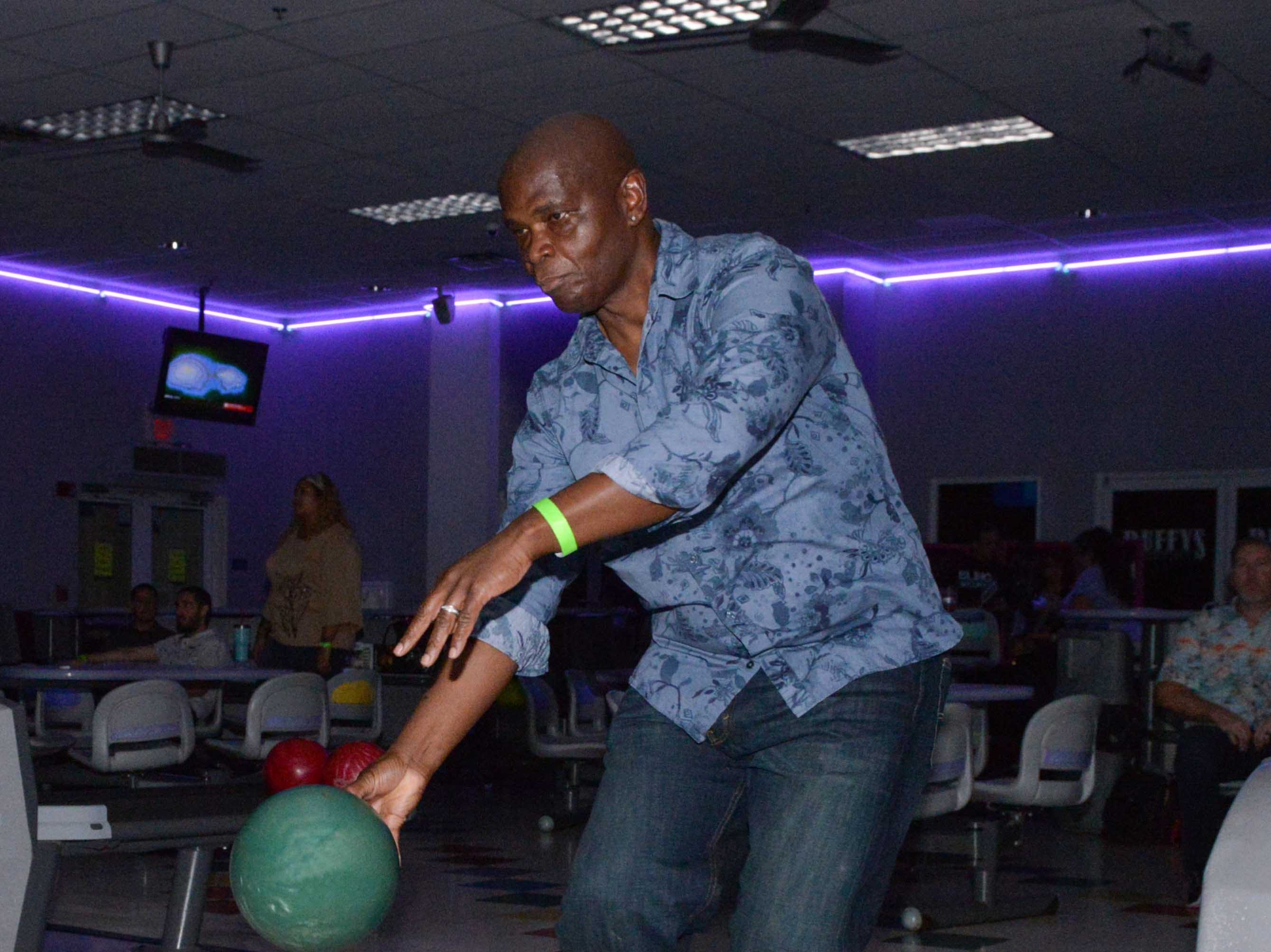 Al Skeete bowls at the Cosmic Family Fun party  to support HANDSof St. Lucie County.