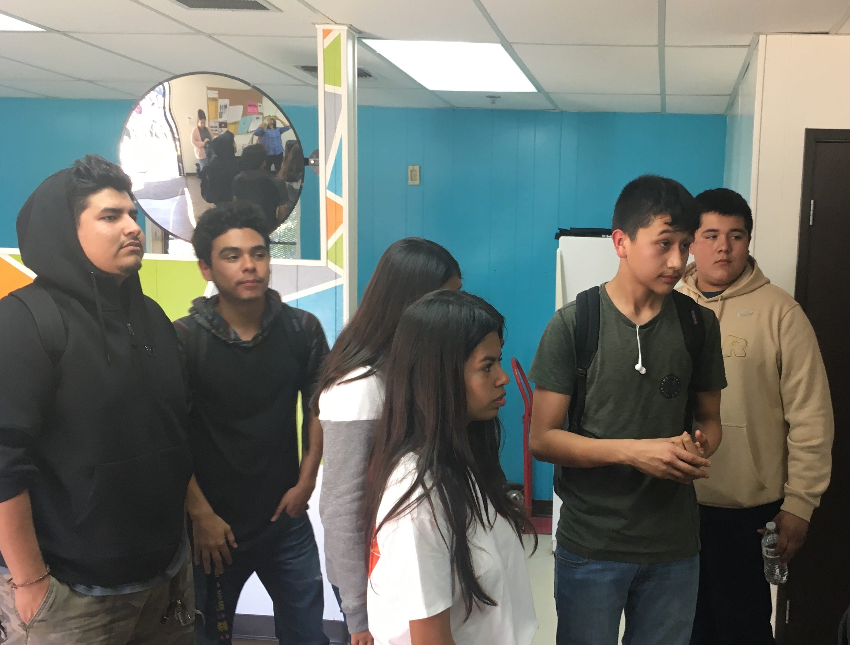 Students tour Santa Paula's new youth center, which has a computer/homework room, a game room, meeting room, lounge area and kitchen.