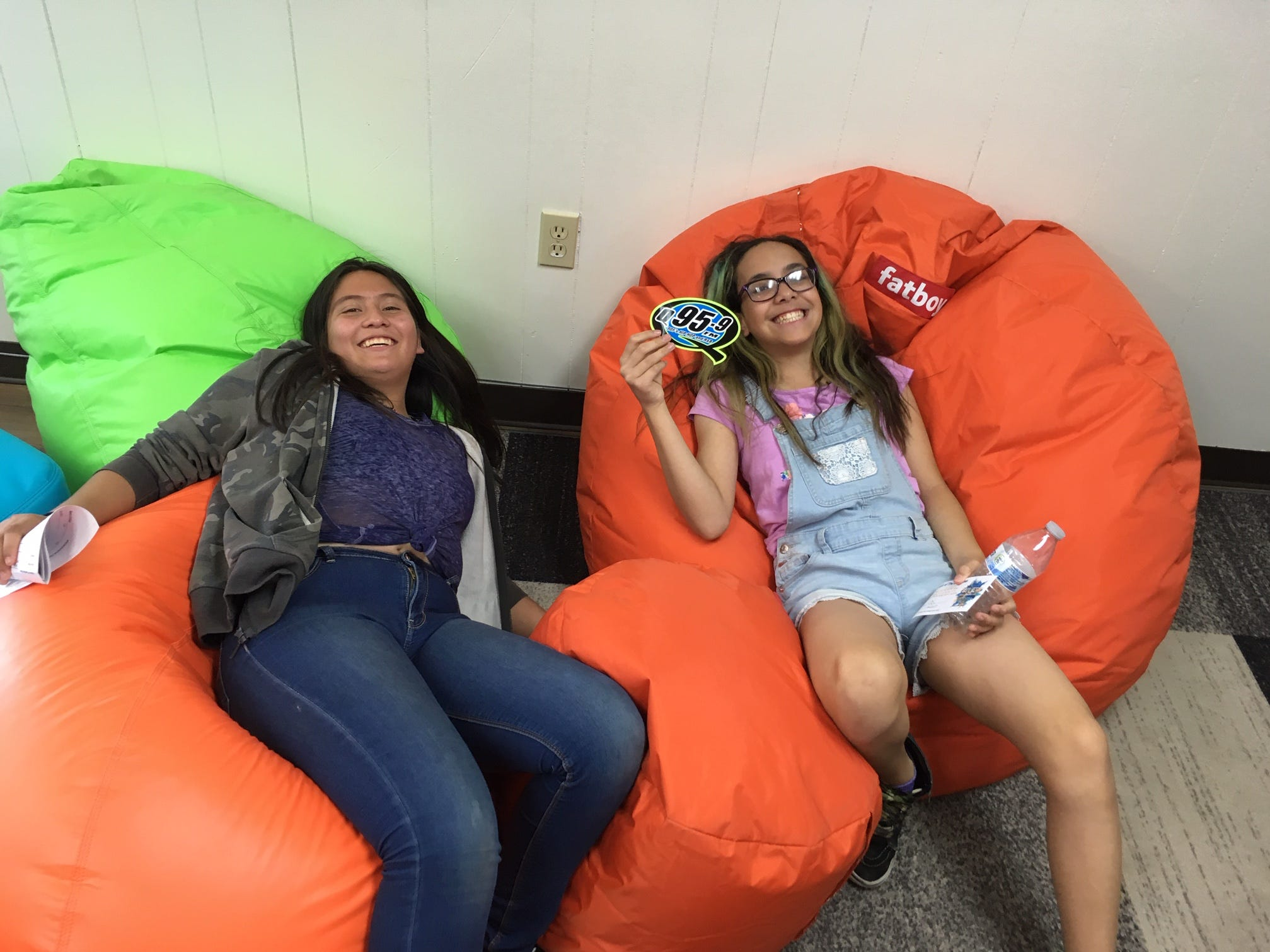 Isbell Middle School students Analily Almanza, 12, and Kylie Soria, 12, hang out in the lounge area of Santa Paula's new youth center.