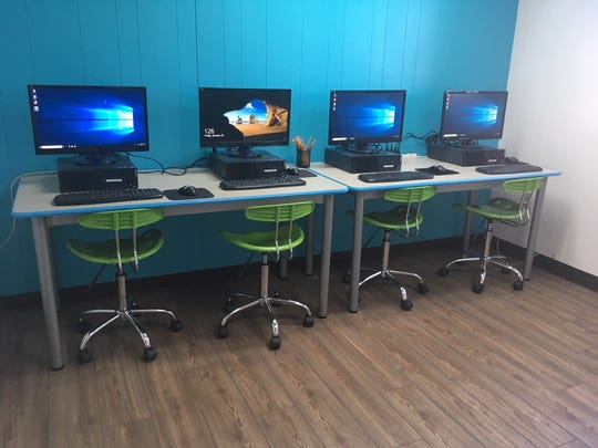 Santa Paula's new teen center has a computer room with four computers and a printer.