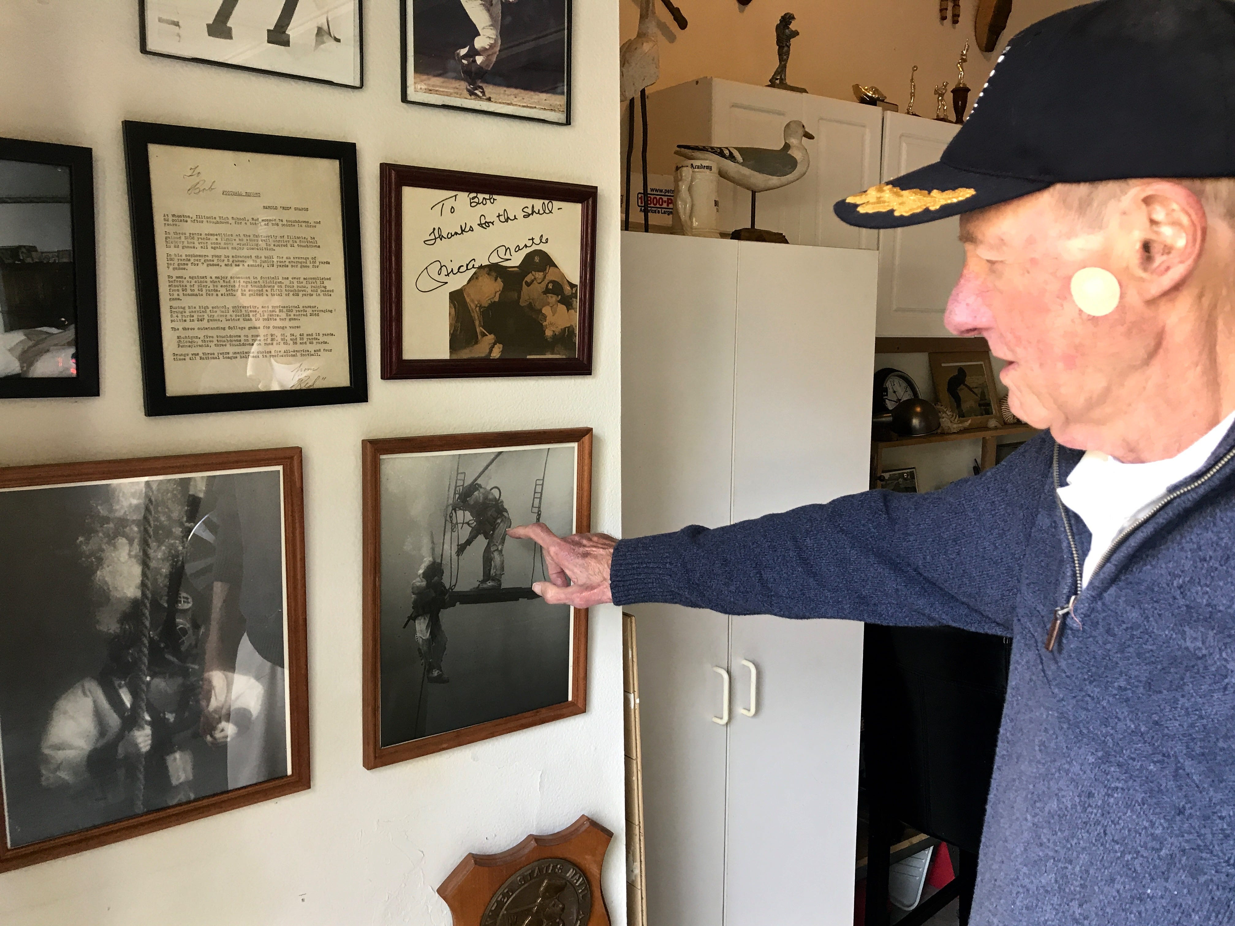 Bob Bornholdt of Camarillo points to photos from his time as an aquanaut in the 1960s Sealab program.