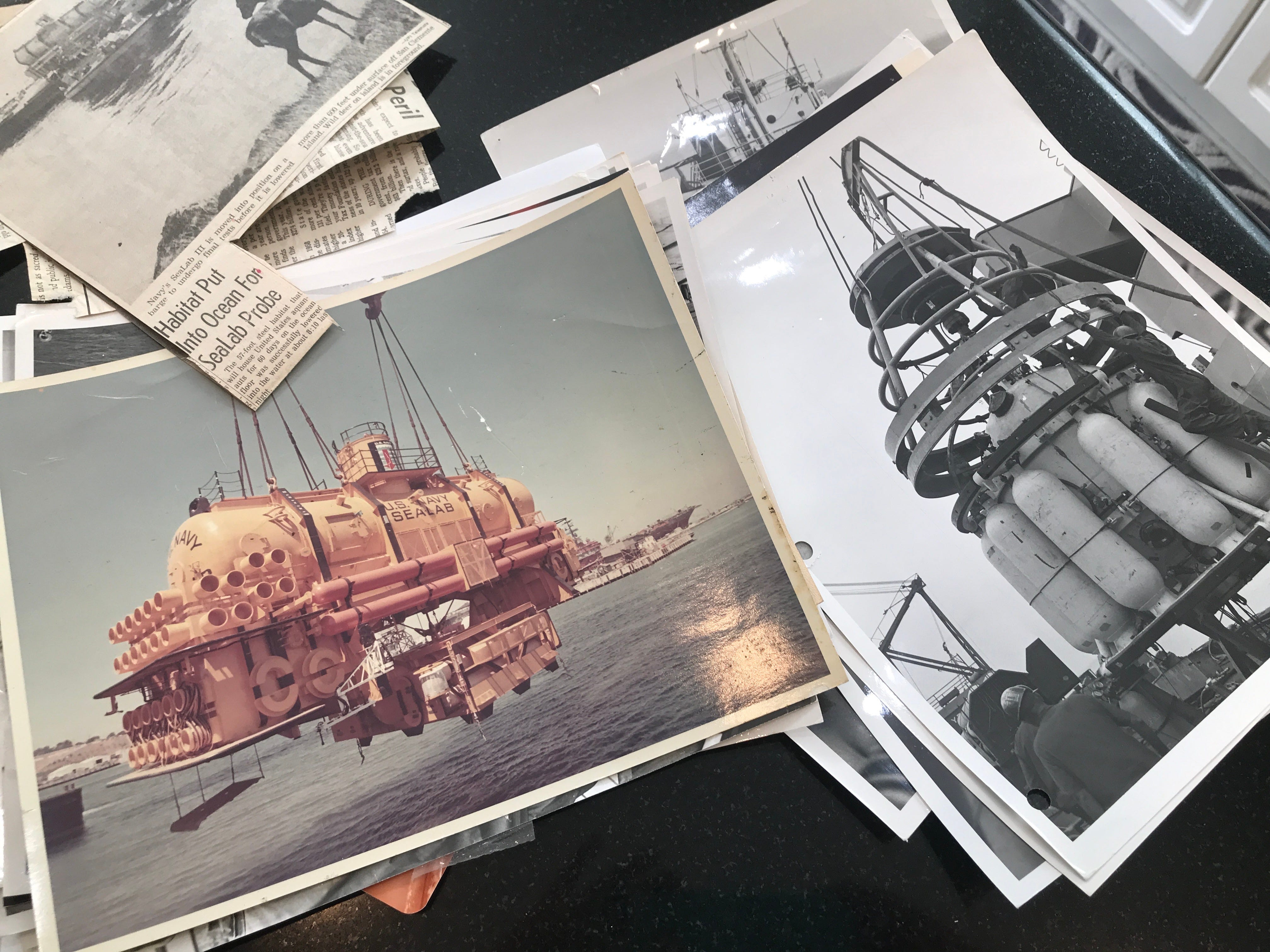 Photos of Sealab 3 and the capsule used to lower aquanauts hundreds of feet below the ocean.