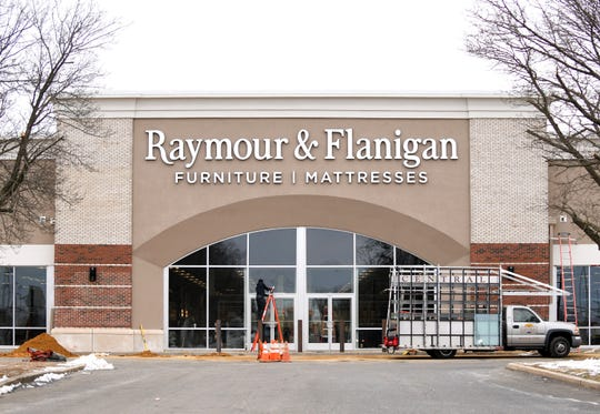 Central Glass and Aluminum employees work on the entrance to Raymour & Flanigan furniture store on Delsea Drive in Vineland on Thursday, Jan. 17, 2019.