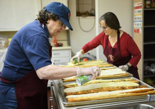 First United Methodist Church soup kitchen volunteers Val Polhanus (left) and Barbara Cline, both from Vineland, help make garlic bread in the church's kitchen on Tuesday, Jan. 29, 2019.