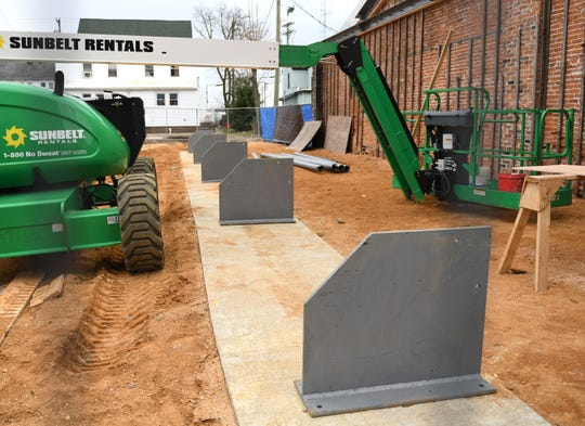 Five steel support footings can be seen next to the parking lot area outside Jim's Lunch in Millville on Tuesday, Jan. 29, 2019.