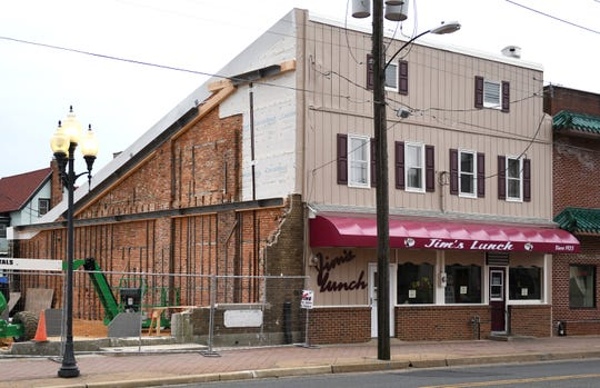 Construction support is almost finished on the building wall outside Jim's Lunch in Millville, pictured here on Tuesday, Jan. 29, 2019.