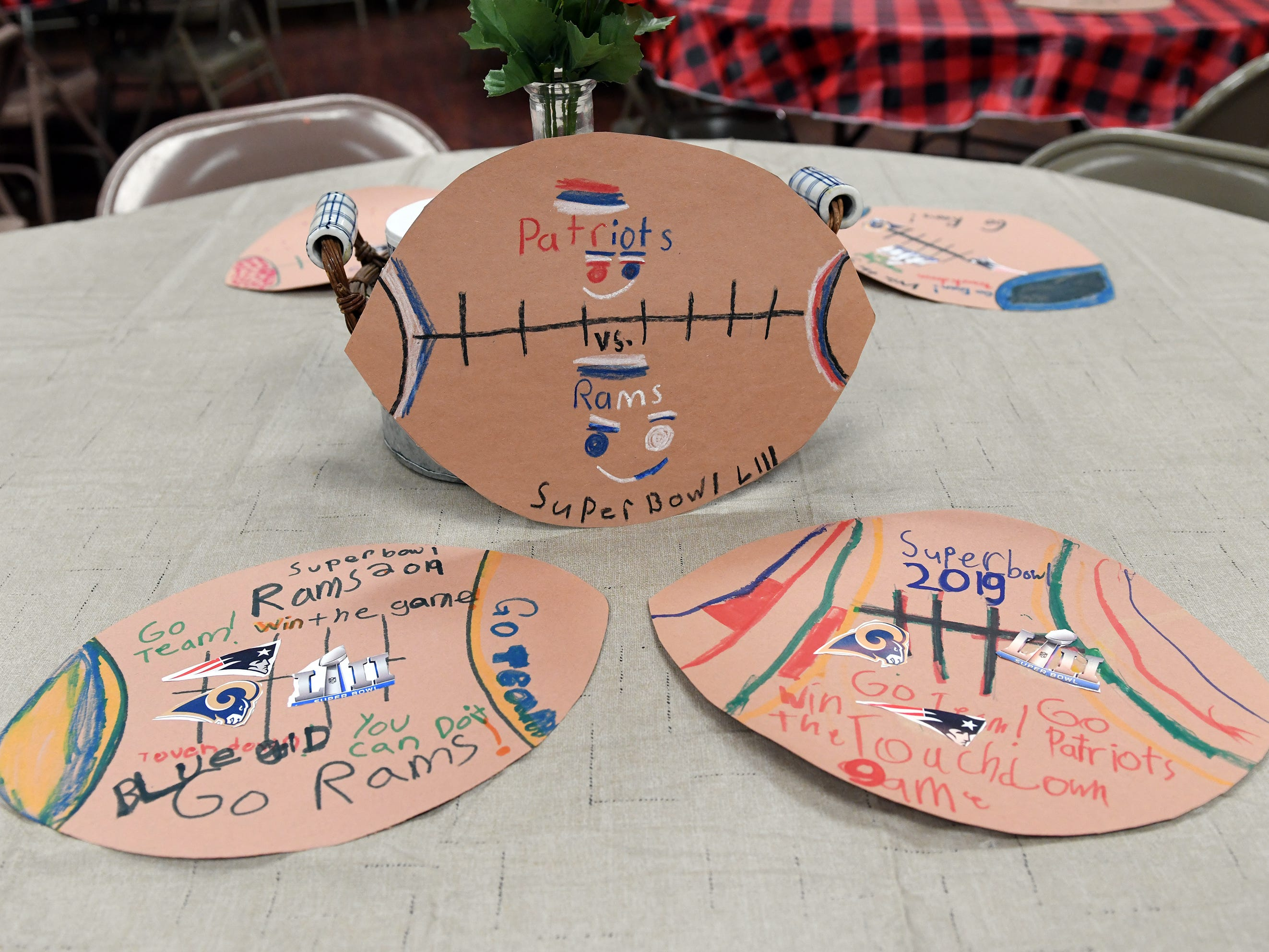 Super Bowl placemats, made by Rossi Elementary School students, are pictured here in the basement of the First United Methodist Church soup kitchen. The church plans to hold a pre-game party on Friday.