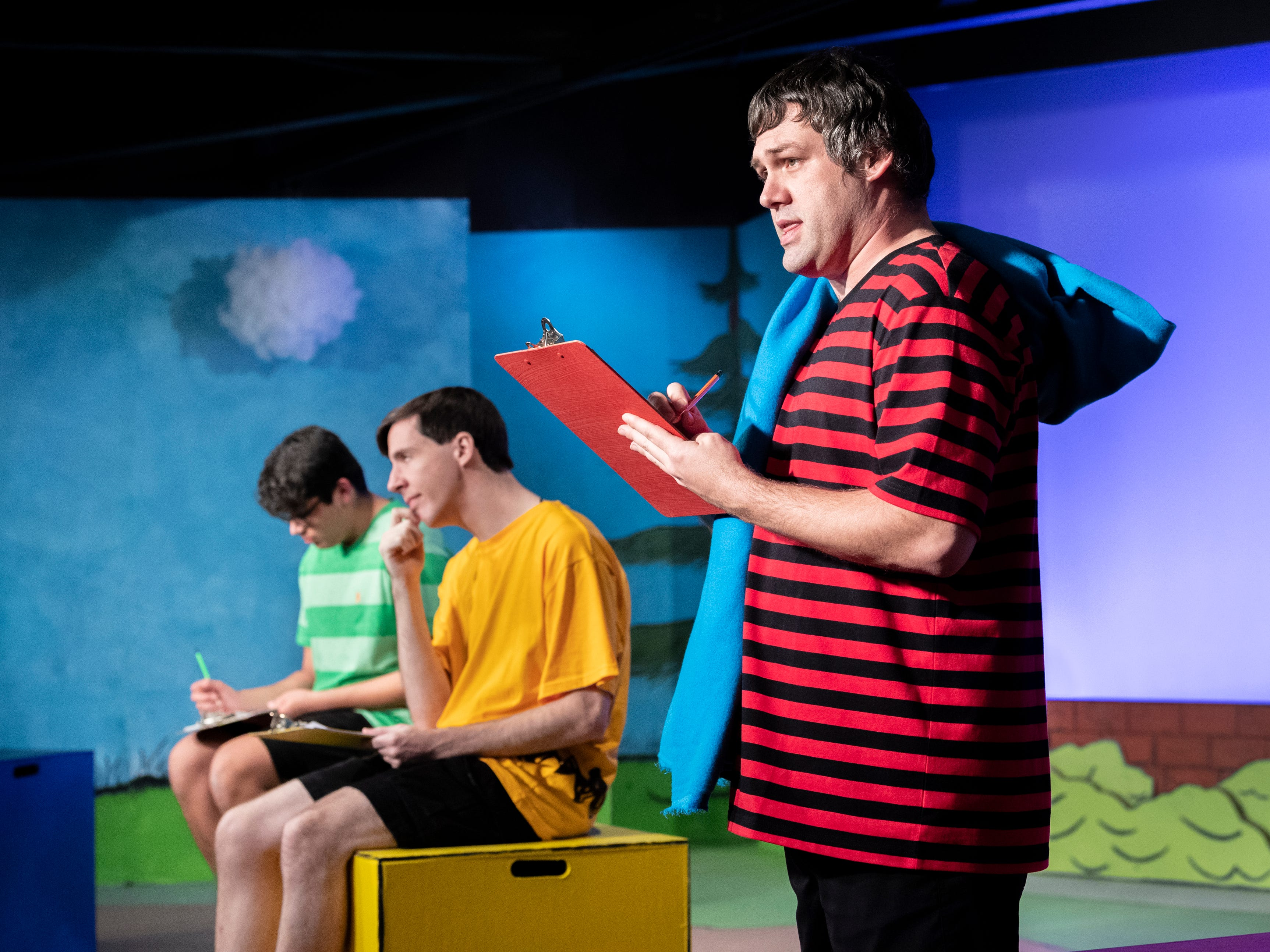 Chris Pinheiro, right,Michael Newman and Andrew Martin rehearse for Encore Theater's production of You're a Good Man Charlie Brown on Monday, January 28, 2019.