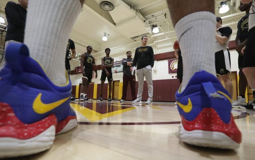 Coach Tobin Anderson, center, talks to the team during basketball practice at St. Thomas Aquinas in Orangeburg Jan. 29, 2019, which is ranked No. 12 in the nation.