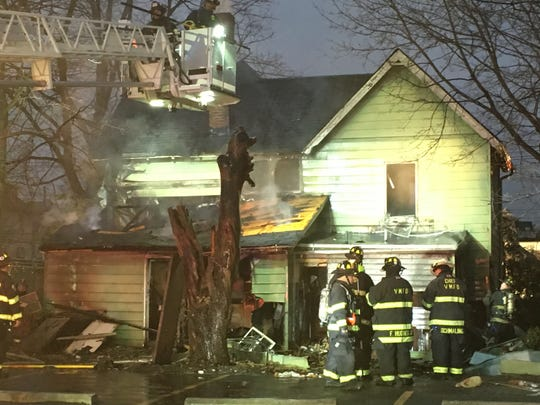 Firefighters battle a house fire on Smith Street in Port Chester, Tuesday, Jan. 29, 2019.