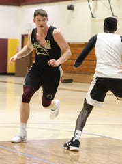 St. Thomas Aquinas' Kevin Lynch, left, formerly of Tappan Zee HS, has been a key player in STAC's success practices with his teammates at St. Thomas Aquinas in Orangeburg on Jan. 29, 2019.