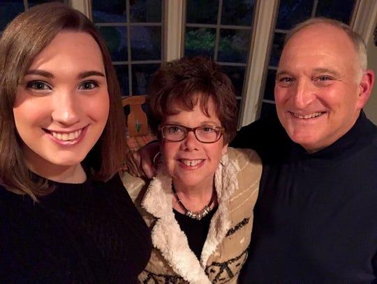 Sally McBride (center) and Dave McBride (right) with their daughter, Sarah McBride (left)
