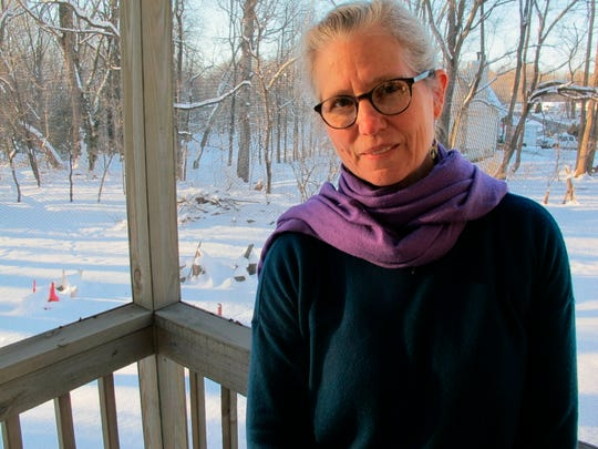 In this Jan. 14, 2019, photo, Carolyn Surrick poses for a photo on the back porch of her home in Annapolis, Md. Surrick has spoken publicly about being sexually abused by two teachers in the 1970s at Key School and wrote about her experience on social media using the hastag #KeyToo, a reference to the #MeToo movement. The Associated Press doesn't normally name victims of sex crimes, but Surrick said she wants to be identified. (AP Photo/Brian Witte)