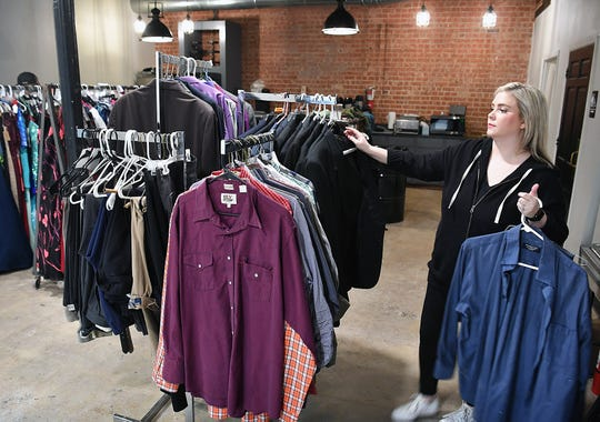 Taylor Mullens displays donated mens formalwear for the upcoming Night To Shine event, a prom night for challenged individuals sponsored by OneLife Community Church February 9.