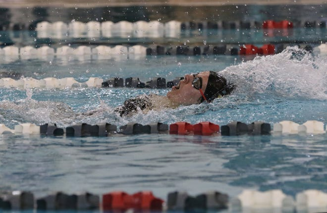 Tri-Valley's Caroline Holmes swims the 100 yard backstroke during the Muskingum County Meet on Monday.