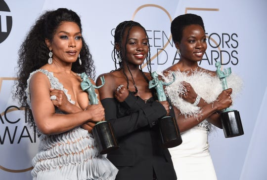 """Black Panther"" co-stars Angela Bassett, Lupita Nyong'o, and Danai Gurira do the Wakanda salute after winning best cast at Sunday's Screen Actors Guild Awards in Los Angeles."