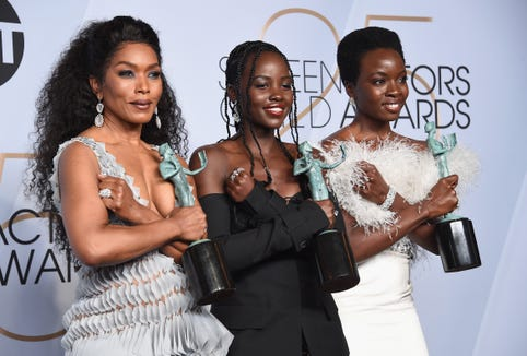 """Black Panther"" co-stars Angela Bassett, Lupita Nyong'o, and Danai Gurira do the Wakanda salute after winning best cast at Sunday's Screen Actors Guild Awards in Los Angeles."