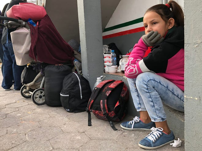 Marlin Judit Martinez, 12, waits in a makeshift camp for migrants under the bridge connecting Matamoros, Mexico, and Brownsville, Texas. Marlin and her family have been trying to cross to the U.S. and seek asylum every day for three weeks.