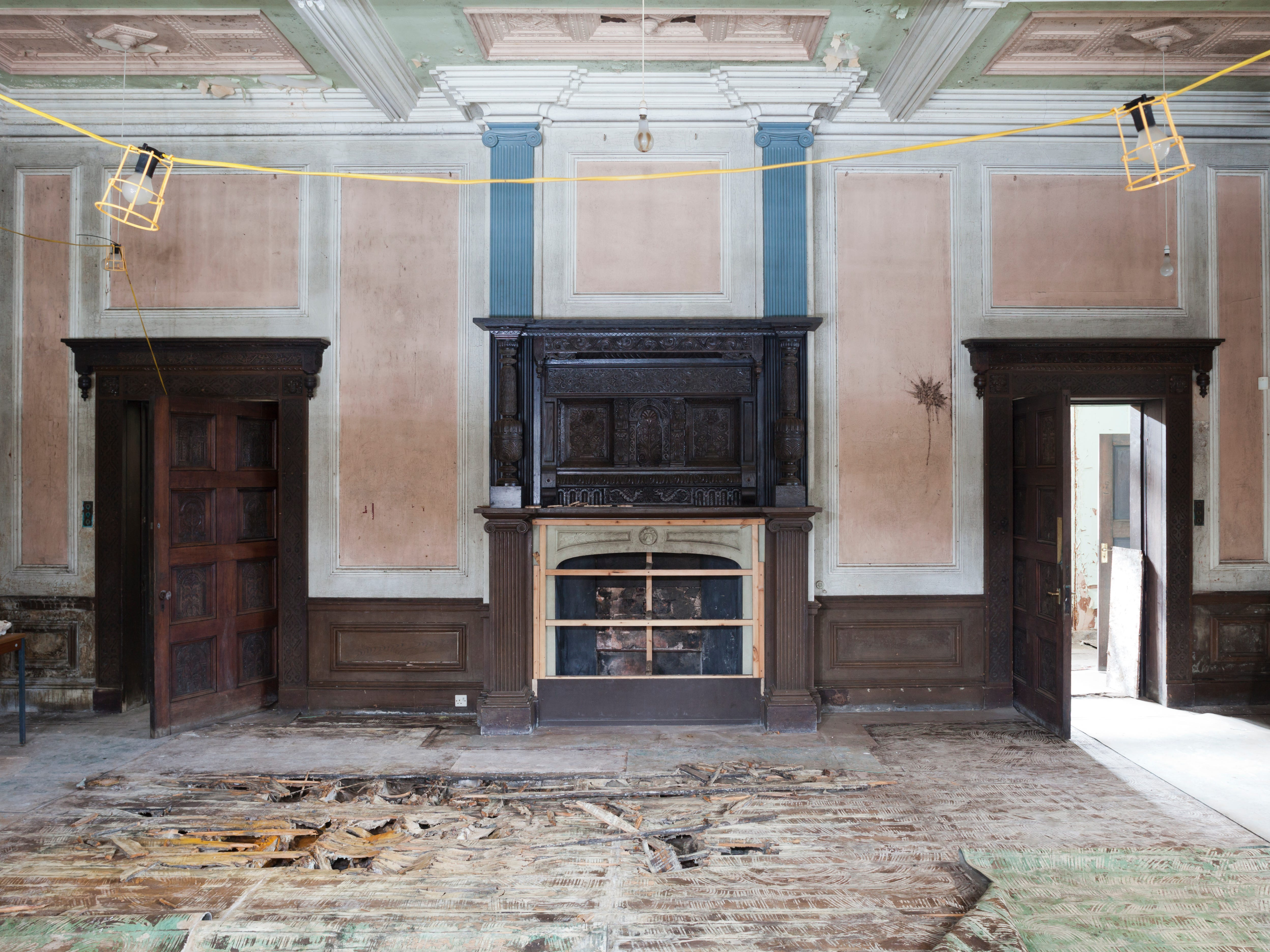 """Hopwood Hall's """"morning room, where breakfast was often served. """"Buttons"""" to summon staff are still visible on the wall."""