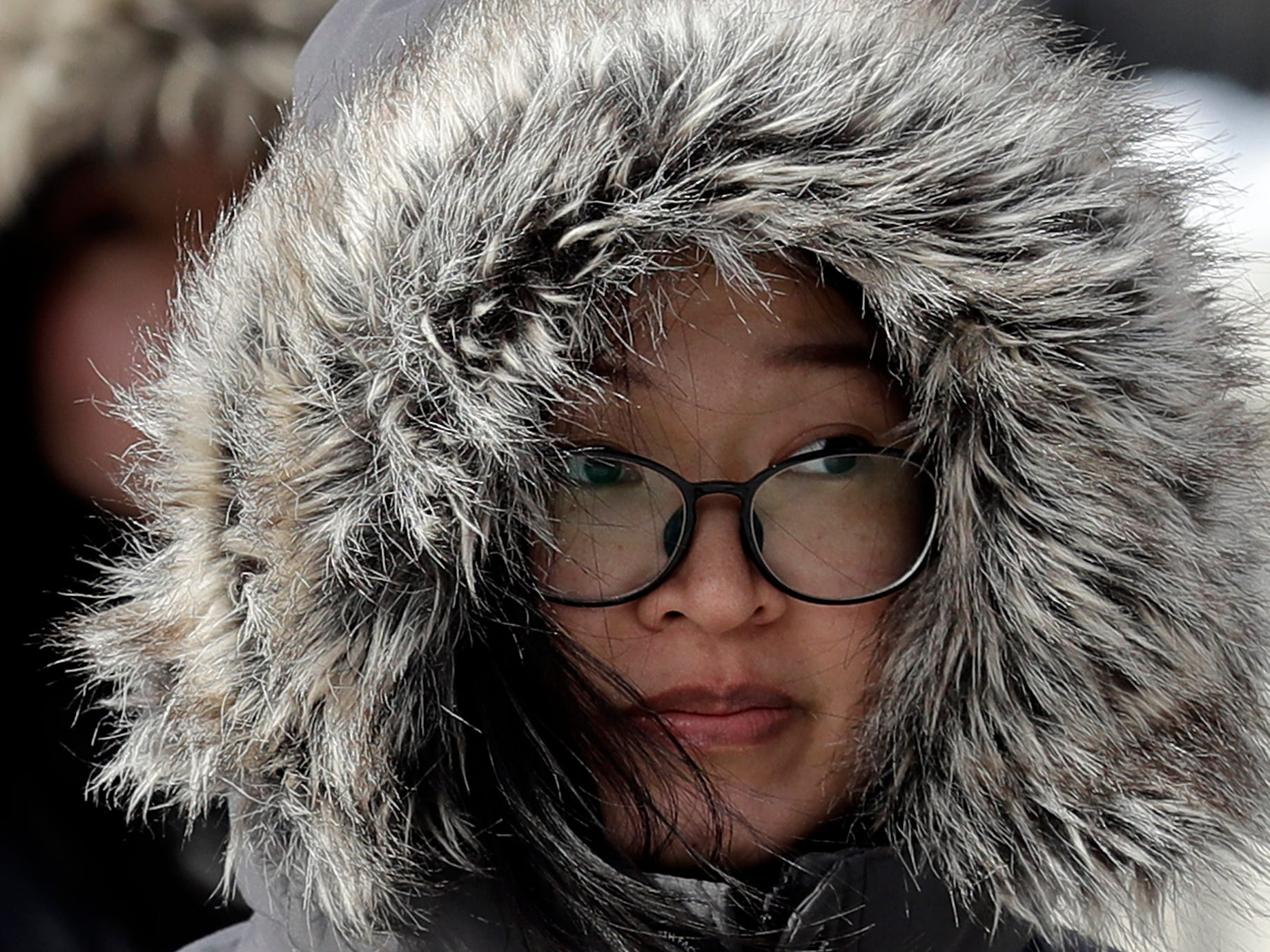 A women is bundled up against Chicago's cold, Jan. 27, 2019.