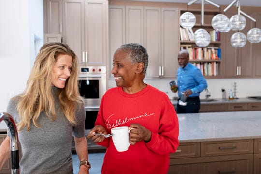 Alex Lerner, left, and B. Smith share a moment as B. drinks tea in their East Hampton home on Long Island, New York, on Jan. 9, 2019. Early onset Alzheimer's robbed B. Smith, a former model, publisher, and restaurateur of her career, along with her memory. Today, she is cared for by her daughter, Dana Gasby, husband Dan Gasby, and her husband's girlfriend, Alex Lerner, at left, none of whom she recognizes.