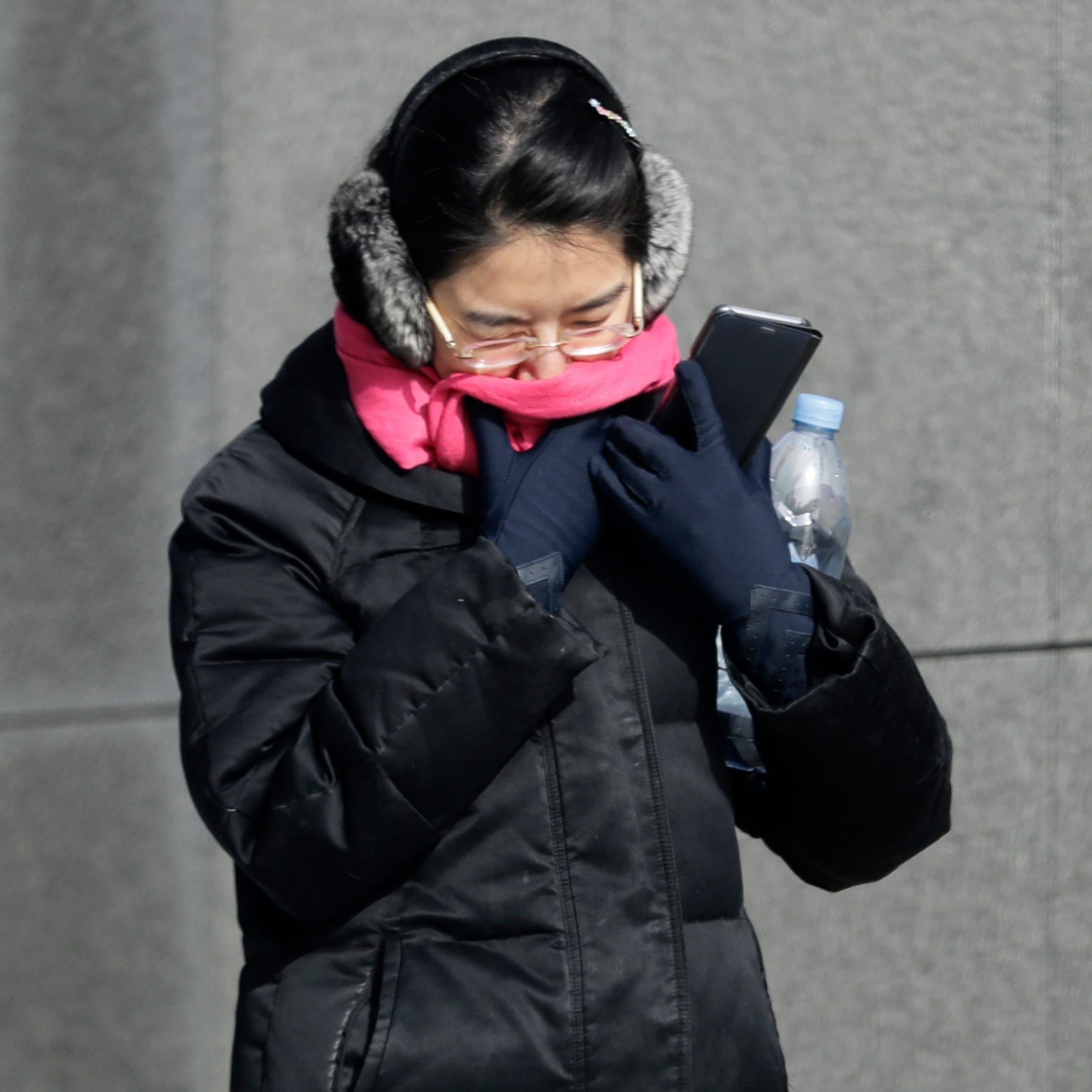 A woman is bundled up against the cold in downtown Chicago, Jan. 27, 2019.