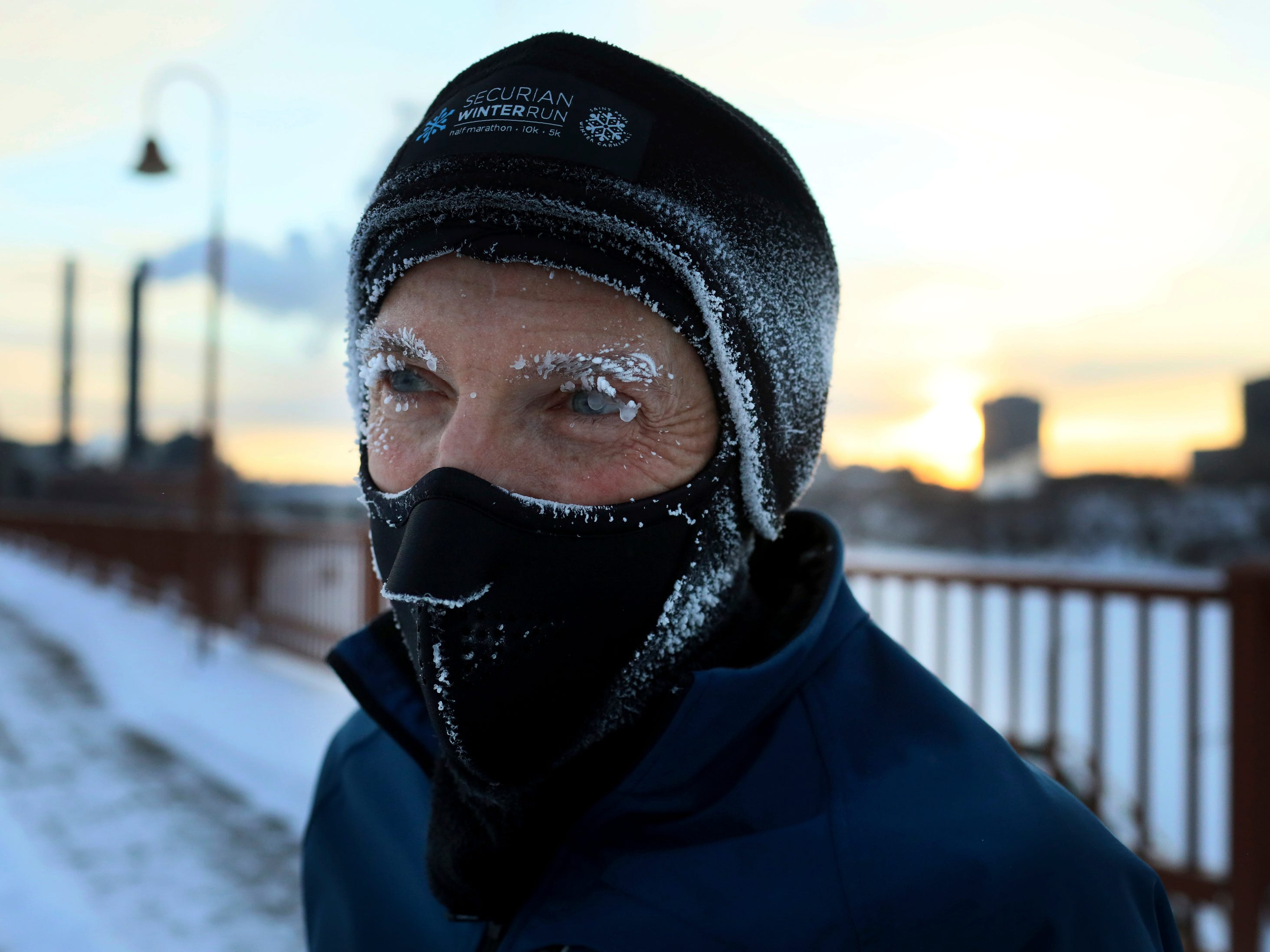 Evan Roberts is covered in frost while jogging across the Stone Arch Bridge In Minneapolis., Jan. 29, 2019.