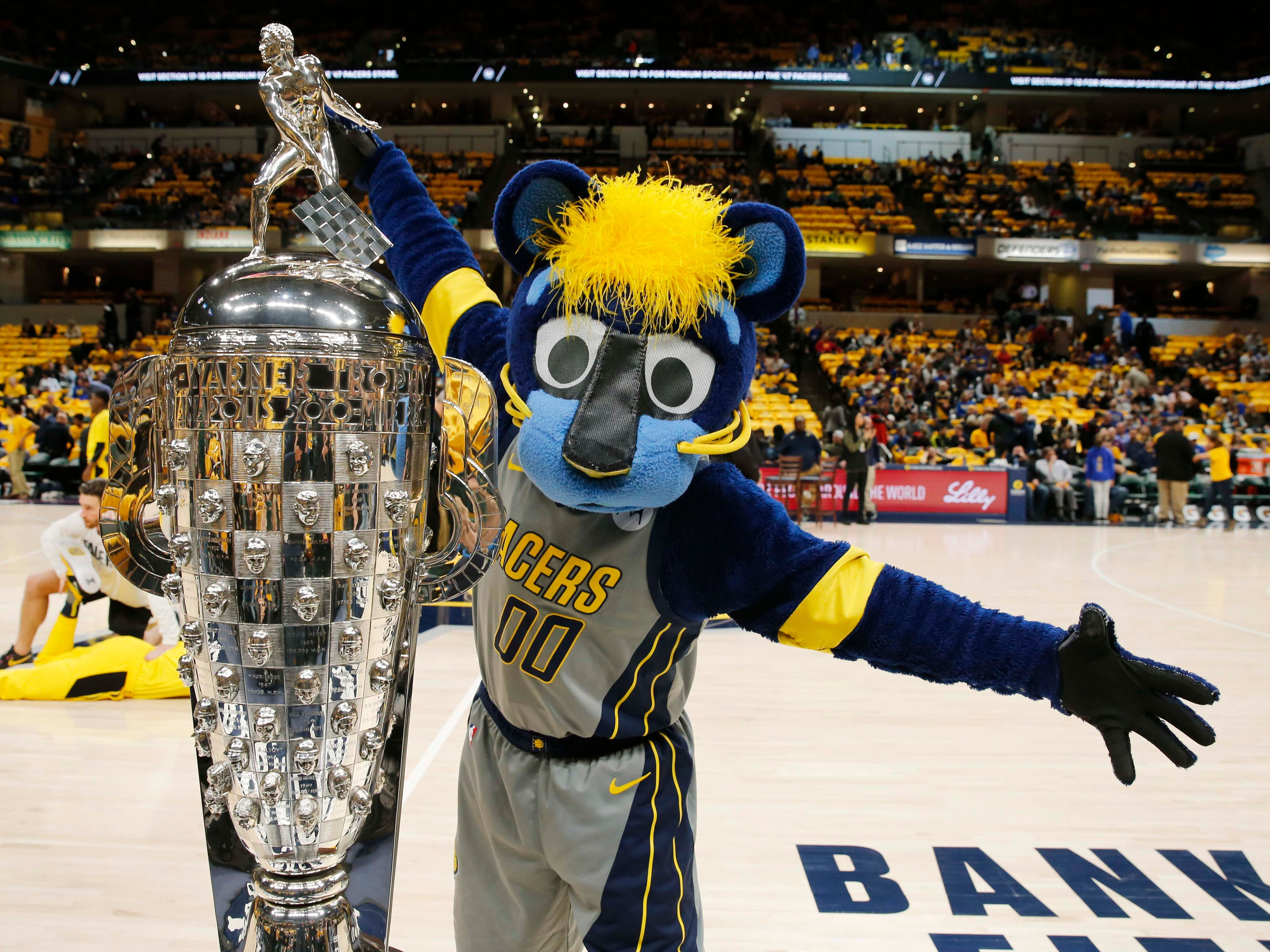 Jan. 28: Pacers mascot Boomer shows off the Borg Warner Trophy, awarded to the winner of the Indianapolis 500, before the Pacers play the Warriors at Bankers Life Fieldhouse.