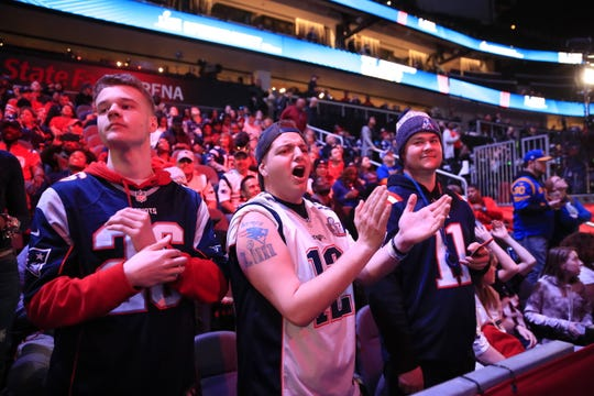 New England Patriots fans in the stands before the start of the Los Angeles Rams session of the National Football League's Super Bowl LIII Opening Night.