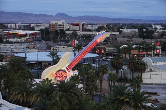 The Hard Rock Hotel neon sign at dusk in Las Vegas.