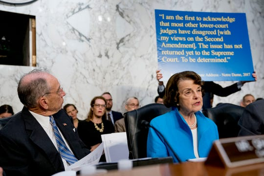 During Supreme Court Justice Brett Kavanaugh's confirmation hearing in October, Democratic Sen. Dianne Feinstein sharply questioned his position on gun rights while a staff member held a poster depicting Kavanaugh's words from 2017.