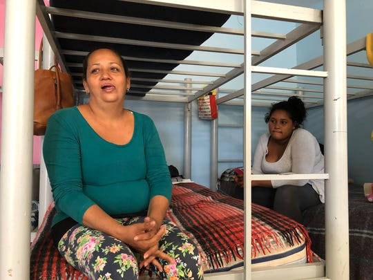 Bessy Meraz Peña, 39, left, and her daughter, Katerin Nasareht, 14, came to Reynosa, Mexico, from their native Honduras three months ago. They said they haven't been able to cross over the international bridge to the U.S. to seek asylum. They were discussing hiring a smuggler to cross them over the Rio Grande. Photo by Rick Jervis, USA TODAY