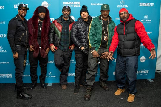 "From left, Wu-Tang Clan members RZA, Ghostface Killah, director Sacha Jenkins and Wu-Tang Clan members U-God, Cappadonna and Masta Killa pose at the premiere of the documentary ""Wu-Tang Clan: Of Mics and Men."""