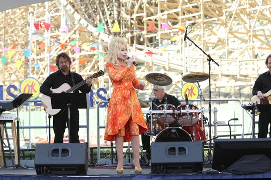Dolly Parton is heavily involved in Dollywood and even performs at the amusement part on occasion.
