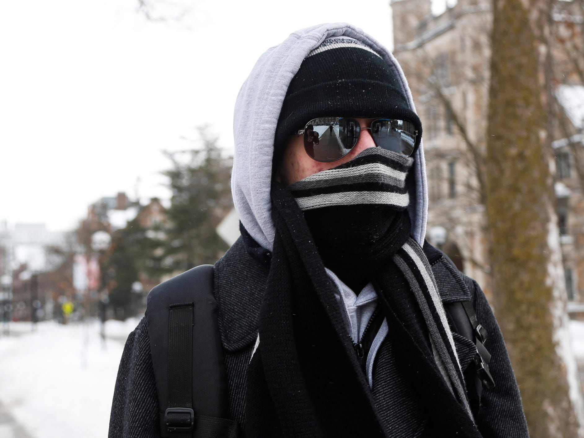 Freshman Ian Fiorini is all covered as he walks across University of Michigan central campus in Ann Arbor, Jan. 29, 2019.