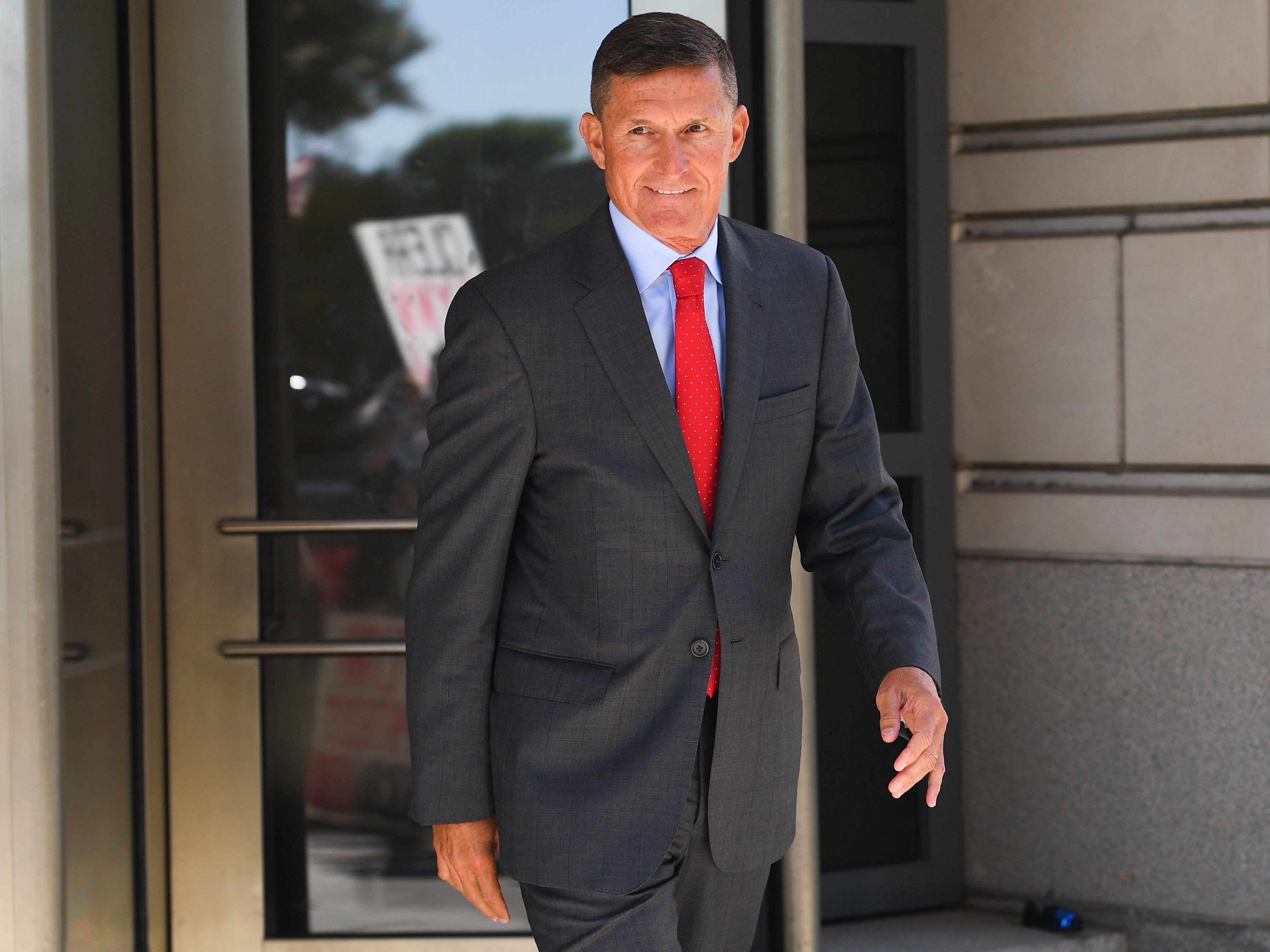 Former national security adviser Michael Flynn leaves after an appearance at U.S. District Court for the District of Columbia.
