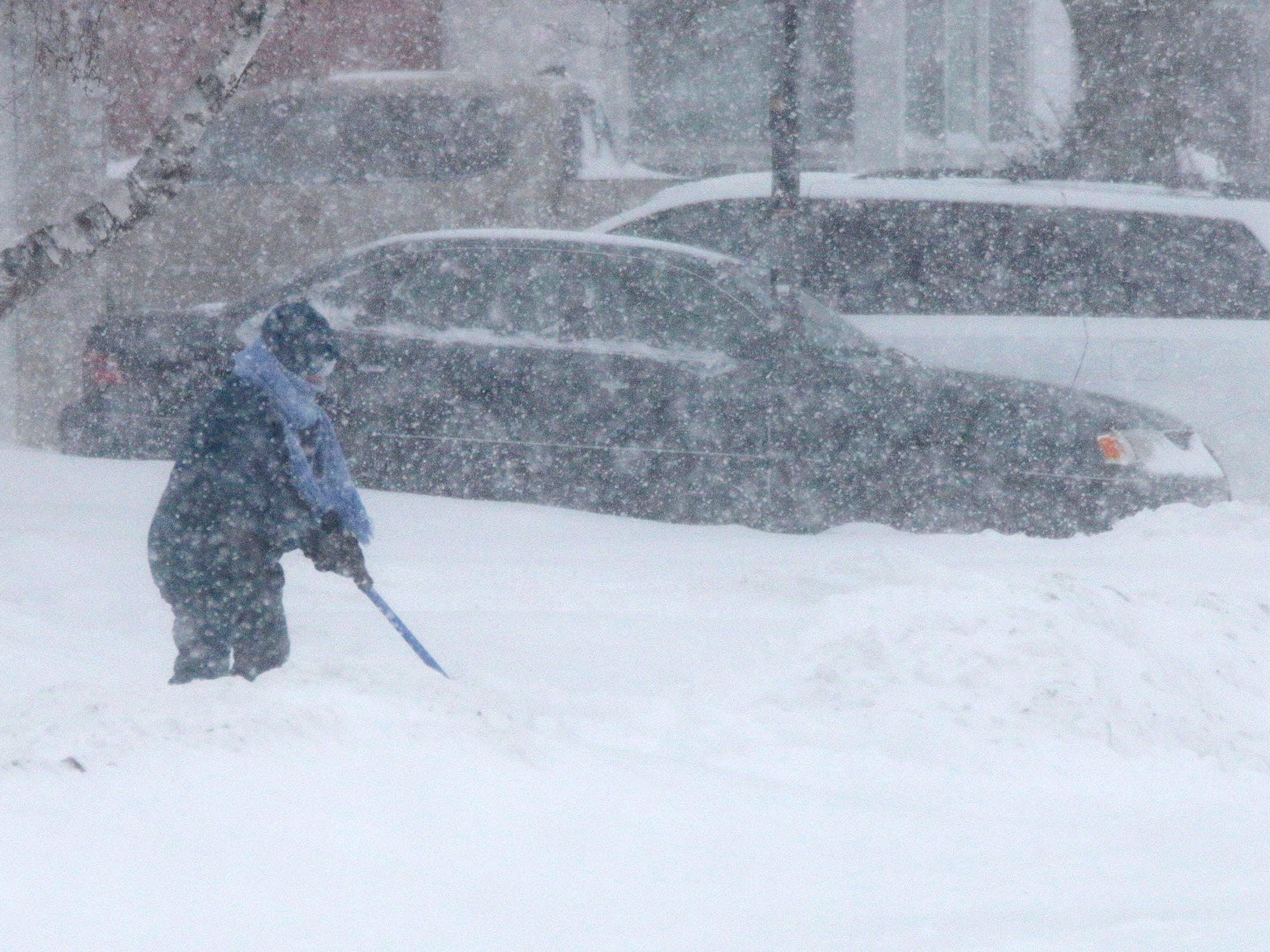 A resident shovels snow in Sheboygan, Wis.