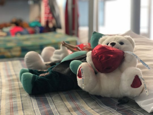 Donated toys adorn bunk beds in the Senda de Vida migrant center in Reynosa, Mexico, just over the bridge from McAllen, Texas. Migrants here have complained that it is nearly impossible to cross through a nearby legal port of entry to seek asylum in the U.S. Photo by Rick Jervis, USA TODAY